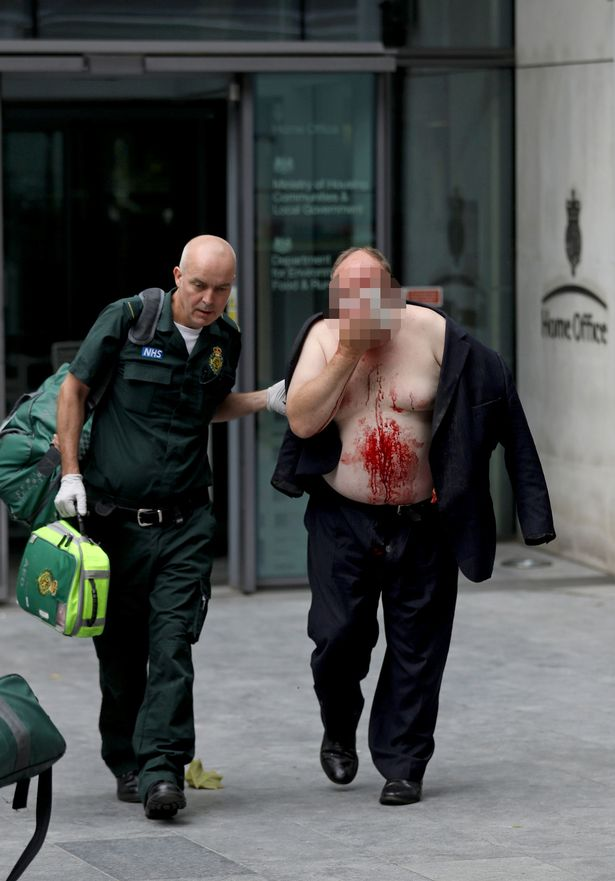 1_An-injured-man-is-helped-by-a-medic-outside-the-Home-Office-in-London.jpg